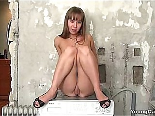 Young Carrie posing outside nude plus showing her pussy